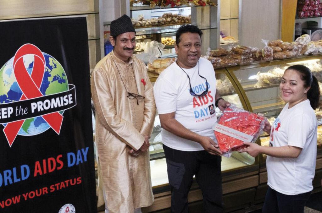 AHF Ambassador Crown Prince Manvendra Singh Gohil (left) and Dr. V. Sam Prasad (middle) deliver condoms to Mizoram