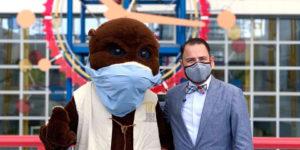 Joe Cox with bear with mask